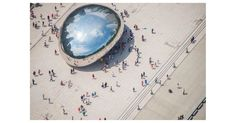 """This soaring image of Chicago's Millennium Park offers a stunning view of """"Cloud Gate,"""" a public sculpture nicknamed """"The Bean."""" This photograph comes from Gray Malin's """"Au Parc"""" series. To capture..."""
