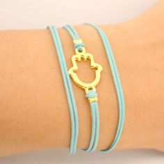 Wrapped hamsa bracelet - turquoise cord wrap bracelet with a gold plated hamsa charm - turquoise string bracelet - against the evil eye.