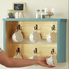 Loving this touch of class for this DIY coffee mug hanger. Change the paint color to match any kitchen decor! Try it with matching mugs or a variety. This is a great gift idea.