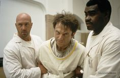 In the Mouth of Madness - Publicity still of Sam Neill, Gene Mack & Kevin Rushton