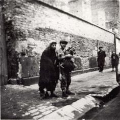 Warsaw, Poland, Jews standing in a ghetto street.  Belongs to collection: Yad Vashem Photo Archive