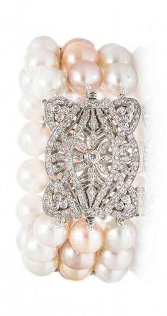 An 18 Karat White Gold, Diamond and Cultured Pearl Bracelet.