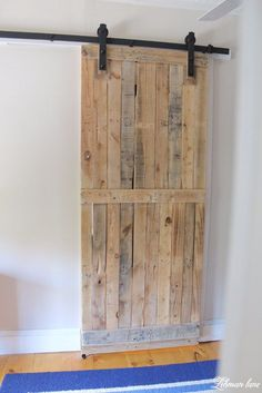 Pallet Furniture Projects Come check out the Pallet Barn Door We Made using only 2 Pallets! - A pallet sliding barn door adds a lot of character, saves space, looks amazing, and is cheap and easy to make. Learn how to build it and build yours today! Wooden Pallet Projects, Wooden Pallet Furniture, Pallet Crafts, Wooden Pallets, Pallet Ideas, Wooden Diy, 1001 Pallets, Diy Wood, Diy Crafts