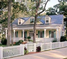 I love a new house that looks old...and a white picket fence. :)