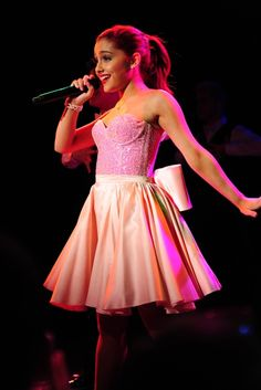 Ariana Grande's fashion is just too cute, bubbly, and feminine. I want a skirt like this but pink with white polka dots, becuase i love Minnie!!