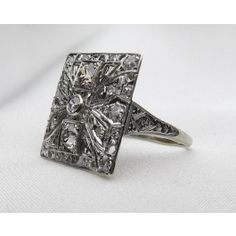 Shop Circa 1930 Art Deco Diamond Platinum Filigree Ring. Perfect as a non-traditional engagement ring or a right hand ring, the vintage handmade ring has a 1.31 carat total diamond weight. Available at isadoras.com.