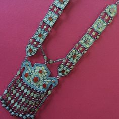 Yomud Turkoman, Eagle gilt silver and carnelian  pendant with dangling bells circa late 20th, early 21st century from Afghanistan.