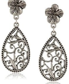 Vintage inspired silver-tone filigree teardrop earrings with feminine flower accents Stainless surgical steel posts with safety clutch Made in the United States Screw Back Earrings, Teardrop Earrings, Vintage Earrings, Women's Earrings, Silver Earrings, Silver Jewelry, Silver Ring, Peridot Earrings, Rhinestone Earrings
