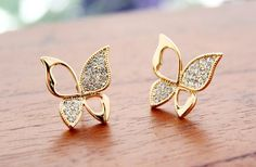 Elegent rhinestone hollow out butterfly wings stud earrings from looback from LoobackStorenvy on Storenvy. Saved to earring. Tiny Gold Hoop Earrings, Gold Earrings Designs, Kids Earrings, Small Earrings, Diamond Earrings, Stud Earrings, Choker Necklaces, Gold Earings Studs, Helix Earrings