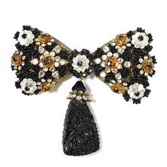 $323.55 Description: This unique, signed Stanley Hagler brooch isnt shy to stand out! Made from black glass beads and clear rhinestones with a Russian gold filigree, it also has a decorative drop down pendant. Stanley Hagler was one of the most respected designers of our time and people collect and cherish his designs all over the world. ...