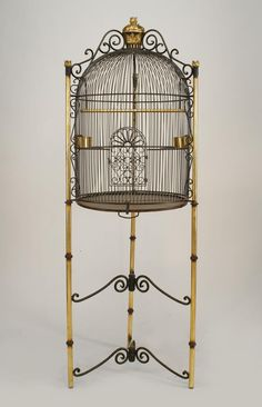 French Victorian Style Black Iron Dome Form Bird Cage Supported On Tripod Base With 2 Scroll Design Stretchers   c. Early 20th Century