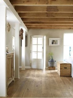 Visible wooden beams under the ceiling wood floors wide plank - light wood floors - dark wood floors Home, House Styles, Interior, New Homes, Exposed Wood, Farmhouse Flooring, House, House Interior, Farmhouse Interior