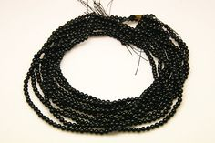 1strand natural black tourmaline plain ball sized 4mm by 3yes