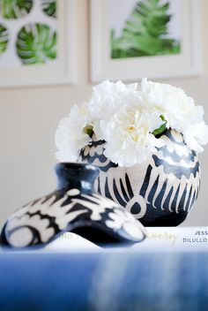 Happy National Flower Day! white carnations are always a favorite as is our handmade pottery, find it at merakihomeaccents.com