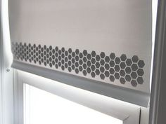 White bathroom roller shade printed with hexagonal stencil