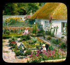 Adare: woman and child in a house garden :: Branson DeCou Digital Archive
