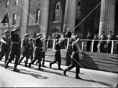 The army passes by the General Post Office during the Easter Sunday Military Parade in General Post Office, History Photos, Photo Archive, More Photos, Dublin, Ireland, Irish, Sunday, Army