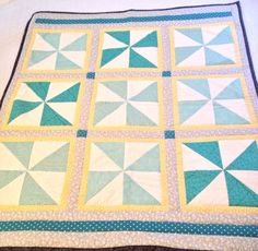 Yellow and Teal pinwheel baby quilt.