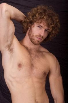 Shirtless hunky redheaded model
