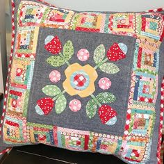 Cabin Posies One of my favorite pillows! I made this at our peep retreat in April and absolutely love it ! It's been fun having it out through spring and summer. Pattern is @beelori1 in Quiltmaker magazine in the Jan/Feb 2016 issue. I used calico days fabric along with other scraps of loris previous fabric lines . #cabinposies #sewsimpleshapes #rileyblake #trimitrulers #lovedmakingthis