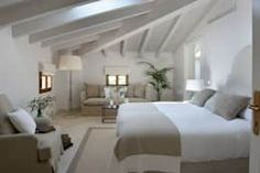 Camera da letto in stile in stile Mediterraneo di Bloomint design