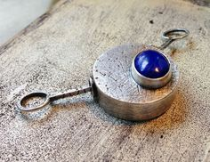 By Sheri Mallery,   Hollow sterling silver box with lapis stone.