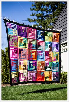 Awesome blanket! http://www.ravelry.com/patterns/library/mitered-square-blanket