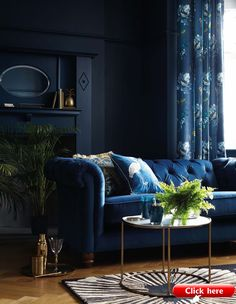 Top 21 interior design trends 2019 2019 navy blue velvet sofa and navy walls in a living room The post Top 21 interior design trends 2019 2019 appeared first on Sofa ideas.