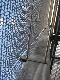 100m stainless steel mesh veil acting as a safety screen Wood Lane underground station, London UK
