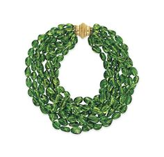 A PERIDOT BEAD NECKLACE, BY VERDURA . Comprising eight strands of variously-shaped peridot beads, joined by a gold clasp, mounted in gold, 15½ ins., two strands deficient, in a Verdura navy leather case Signed Verdura . Christie's . Price $ 20.000