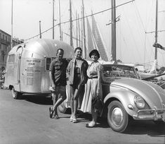 Vintage photo showing a '50s Karmann Kabriolet polling an Airstream Basecamp.