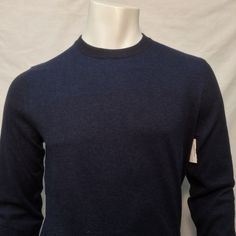 -Crew neck -Small dot pattern at shoulder -Small logo tag at side seam -85%Cotton 10% Silk 5% Cashmere -Regular Fit Pictured with Hugo Boss pants that can be found by clicking here.
