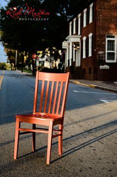 Red Chair On Main Street With Holladay House In The Background