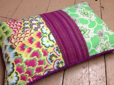 Patchwork cushion made using fabrics and trim from our shop
