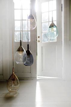 A Lute pendant lamp, clear w gold, 49cmH is the perfect accessory for a dark…