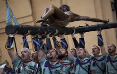 Members of the Spanish Legion, an elite unit of the Spanish Army, hold up the El Cristo de la Buena Muerte, or Christ of the Good Death, during a ceremony ahead of the procession in Malaga, Southern Spain. Hundreds of processions take place throughout the country during the Easter Holy Week. (AP)