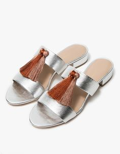 Double strap sandal from Loeffler Randall. Silver goatskin upper with silky Pink Clay tassel accents at vamp. Padded footbed. Low stacked heel.  • Leather upper • Leather sole  • Made in Brazil