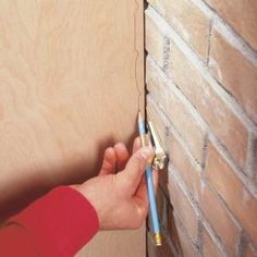 How to Scribe for a Perfect Fit. Fit woodwork perfectly to even the waviest walls with an inexpensive compass.