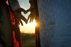 The sun shining through a heart. | 42 Impossibly Fun Wedding Photo Ideas You'll Want To Steal