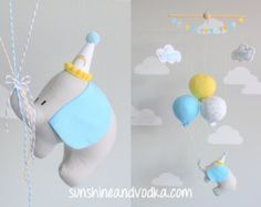 Gender neutral nursery décor, hot air balloon baby mobile in mine and grey for a travel theme nursery. Hot air balloon baby mobile nursery décor