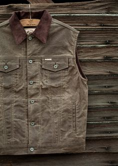 The versatile Rambler Vest is handmade in the USA from heavy-duty 10oz. Martexin waxed cotton canvas that's designed to face rugged conditions year after year. A classic fit with maximum core mobility and plenty of pocket space, we gave it a tack button and zippered front closure to keep the wind from cutting through when it's time to ramble on. THE SPECS + DETAILS 100% Cotton 10oz. Martexin™ Waxed Canvas Corduroy collar, interior cuff, under pocket flap Tack button and zippered front closure Bu Waxed Canvas, Cotton Canvas, Hunting Clothes, Vest Jacket, Corduroy, Men Casual, Mens Fashion, Denim, My Style