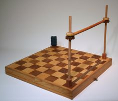 Book Sewing Frame repurposing a folding chess board by Janet Hickey of Smart Aleck Studio