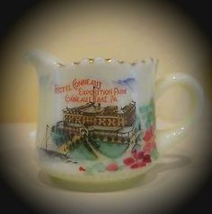 Custard glass small pitcher souvenir.