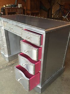 Antique desk up cycled with aluminum roof flashing. Contrast drawers
