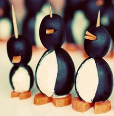 Cream cheese, olive, and carrot penguins!