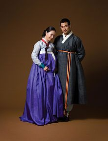 """Hanbok (South Korea) or Chosŏn-ot (North Korea) is the traditional Korean dress. It is often characterized by vibrant colors and simple lines without pockets. Although the term literally means """"Korean clothing"""", hanbok today often refers specifically to hanbok of Joseon Dynasty and is worn as semi-formal or formal wear during traditional festivals and celebrations. The modern hanbok does not exactly follow the actual style as worn in Joseon dynasty since it went through some major changes…"""