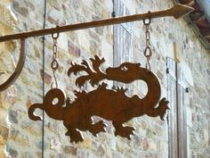 cut a shape from metal or wood and hang from chains ... must do