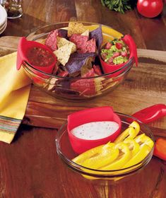 """Sets of 3 Dip Bowl Hangers Set of 3 Dip Bowl Hangers turns any bowl into a chip 'n' dip server. Simply hang one on the rim of a larger bowl with the round portion inside the serving bowl. The 3-oz. hanger holds a generous serving of dip, salsa, nuts, candy and more. Soft and flexible silicone. 4-1/4"""" x 2-3/4"""" x 2-1/2"""". Top-rack dishwasher safe. Just hang it on any bowl Makes serving nuts or dip easy Details: Silicone Each holds 3 oz. 4-1/4"""" x 2-3/4"""" x 2-1/2"""" Top-rack dishwasher safe $4.95 set"""