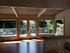 Beautiful wood French patio doors and 3 large picture windows replaced in Bellevue. Patio door was a cutout from existing picture window.