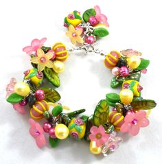 A Wrist Full of Flowers - Jewelry creation by Madalynne Homme Wire Wrapped Jewelry, Wire Jewelry, Jewelery, Flower Jewelry, Flower Necklace, Bracelet Making, Jewelry Making, Star Magazine, Wire Wrapping